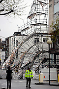 © Licensed to London News Pictures. 29/04/2012. London, UK . Police guard the scene. Heavy winds have caused a large section of scaffolding to collapse on building work being carried out for a new Jamie Oliver restaurant on Notting Hill Gate in West London today 29th April 2012. The structure came down at approx 0300am across a main road junction and nobody was hurt. The  Photo credit : Stephen Simpson/LNP