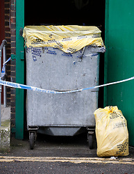 © Licensed to London News Pictures. 20/03/2017. London, UK.  A bin covered using police evidence tape and a hazardous waste bag at the scene at a block of flats in Hoxton where a man's body was found. Officers found the victim, in his 20s, who  was unresponsive shortly after 12.30pm on Sunday. A murder investigation has been launched after a 28 year old man was arrested. Photo credit: Peter Macdiarmid/LNP
