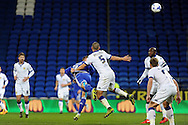 Cardiff City's Anthony Pilkington (blue) heads at goal while challenged by Leeds Guiseppe Bellucci (5). Skybet football league championship match, Cardiff city v Leeds Utd at the Cardiff city stadium in Cardiff, South Wales on Tuesday 8th March 2016.<br /> pic by Carl Robertson, Andrew Orchard sports photography.