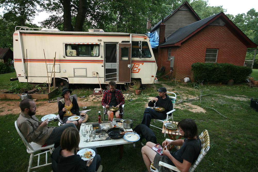 Pittsboro, NC - May 13: The group eats dinner at  the farm at Circle Acres. (Photo by Logan Mock-Bunting)