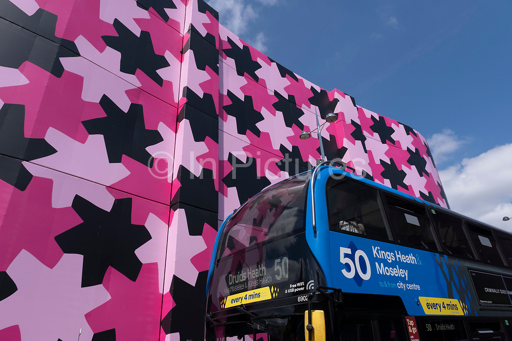 Refurbishment of the iconic Selfridges building in the city centre on 14th July 2021 in Birmingham, United Kingdom. The exterior of the building has been wrapped in scaffolding and a pink protective covering while it undergoes renovation while the discs are cleaned and repainted in its original colour.