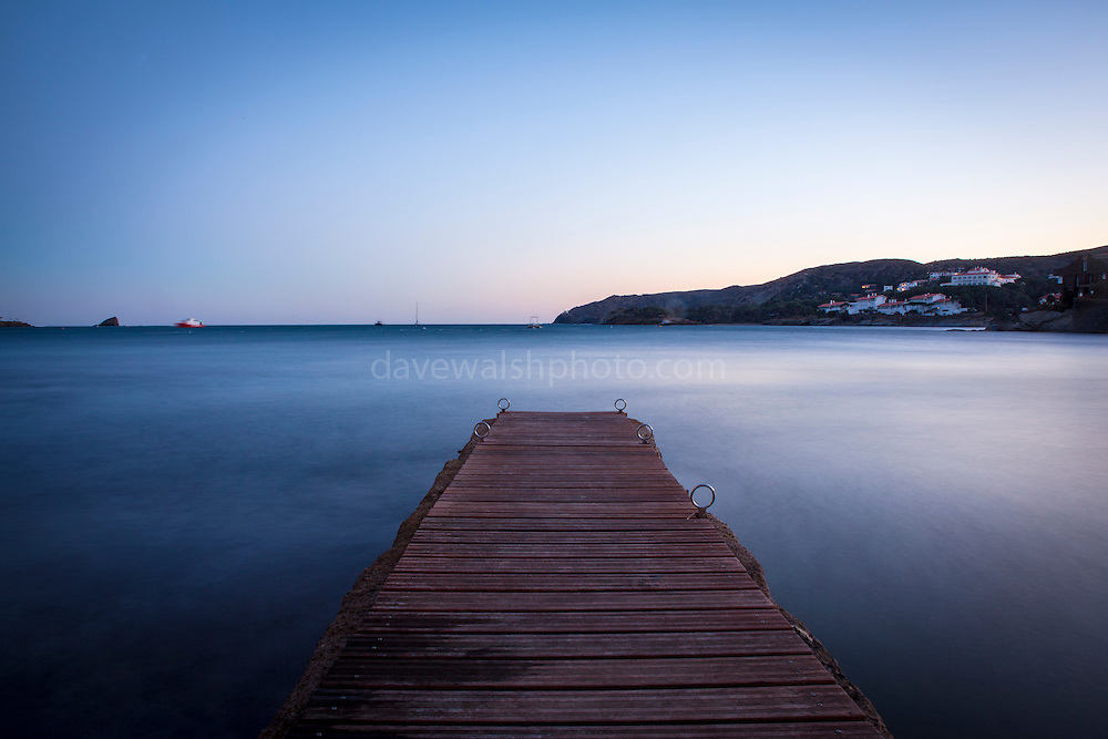 """Long exposure, December light falls on the harbour jetty in Cadaqués, Catalonia. This mage can be licensed via Millennium Images. Contact me for more details, or email mail@milim.com For prints, contact me, or click """"add to cart"""" to some standard print options."""