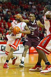 18 January 2009: Chris Cooks all but clothes lines Emmanuel Holloway who is headed to the hoop. The Illinois State University Redbirds top the Missouri State Bears 68-56 on Doug Collins Court inside Redbird Arena on the campus of Illinois State University in Normal Illinois