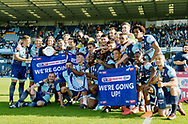 Wycombe Wanderers players celebrate promotion during the EFL Sky Bet League 2 match between Wycombe Wanderers and Stevenage at Adams Park, High Wycombe, England on 5 May 2018. Picture by Alistair Wilson.