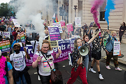 London, UK. 24th July, 2021. Trans rights campaigners hold smoke grenades on the first-ever Reclaim Pride march. Reclaim Pride replaced the traditional Pride in London march, which many feel has become too commercial and strayed from its roots in protest, and was billed as a People's Pride march for LGBTI+ liberation.