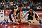 .Navajo Pine Warriors Timothy Chee (1) and Joshua Poyer (4) battle for a loose ball with Hagerman Bobcat Edward Montoya (1) during the first half of Wednesday nights game at the Santa Anna Star Center in Rio Rancho NM. Hagerman defeated Navajo Pine 76-61.
