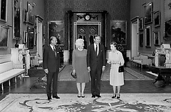 File photo dated 01/06/89 of US President George Bush, his wife Barbara, the Duke of Edinburgh and Queen Elizabeth II, in the Picture Room at Buckingham Palace. The Royal couple will celebrate their platinum wedding anniversary on November 20.