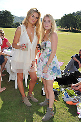Left to right, FRANCESCA PORTER and CONNIE ALLFREY at a cricket match to in aid of CARE - Corfu Animal Rescue Establishment held at Hawkley Cricket Club, Hawkley, Hampshire on 8th September 2012.