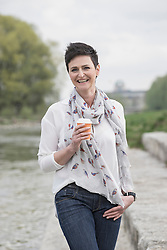 Mature woman drinking coffee with smiling, Bavaria, Germany