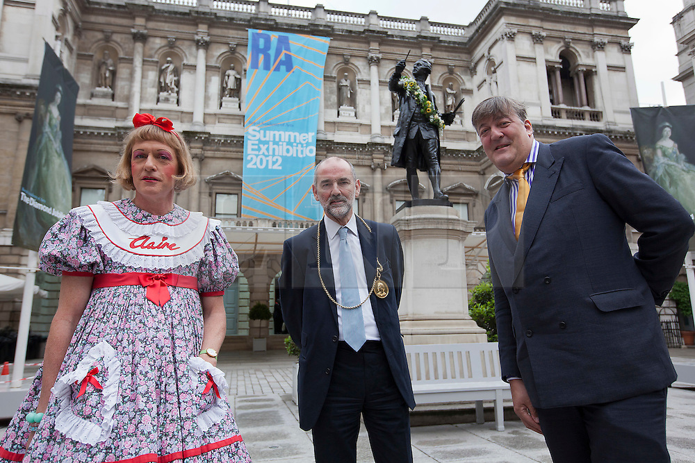 © Licensed to London News Pictures. 07/06/2012. LONDON, UK. Television presenter, and trustee of the Royal Academy, Stephen Fry (L),  President of the Royal Academy of the Arts Christopher Le Brun (C) and artist Grayson Perry (R) stand in the courtyard of the Royal Academy today (07/06/12) ahead of unveiling plans for the Keeper's House. The Keeper?s House is a major new building project to create beautiful new spaces alongside the Royal Academy for RA Friends, Royal Academicians and the general public in the heart of London. Photo credit: Matt Cetti-Roberts/LNP