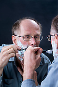 male person shaving his beard