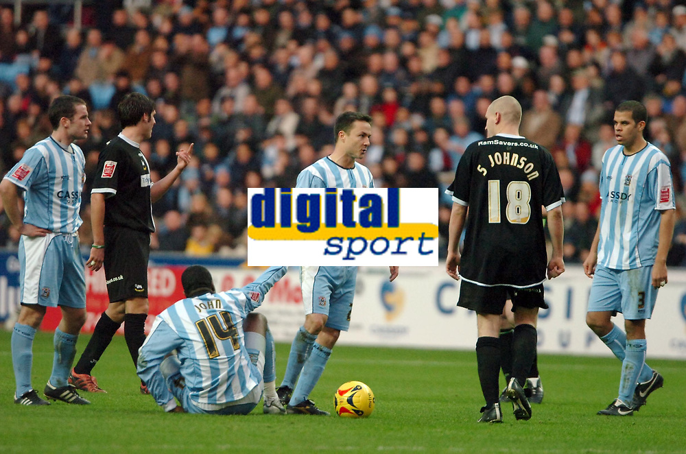 Photo: Ed Godden.<br />Coventry City v Derby County. Coca Cola Championship. 21/01/2006. <br />Coventry's Dennis Wise isn't pleased with Seth Johnson's tackle on Stern John.