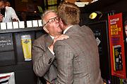 Boekpresentatie Huisje Boompje Buikje - Bastiaan Ragas  in Cafe Gruter, Amsterdam.  De nieuwe verhalenbundel is een pleidooi voor de ouwe lul 2.0<br /> <br /> op de foto:  Bastiaan Ragas reikt het eerste exemplaar uit aan zijn vader Ben Ragas