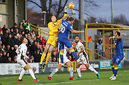 AFC Wimbledon striker Cody McDonald (10) battles for possession with Walsall goalkeeper Liam Roberts (13) during the EFL Sky Bet League 1 match between AFC Wimbledon and Walsall at the Cherry Red Records Stadium, Kingston, England on 25 November 2017. Photo by Matthew Redman.
