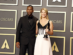 Laura Dern and Mahershala Ali at the 92nd Academy Awards - Press Room held at the Dolby Theatre in Hollywood, USA on February 9, 2020.