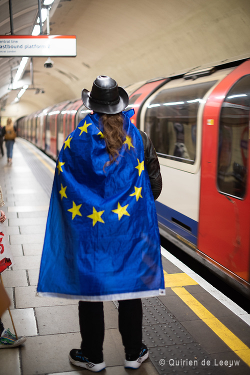A Pro-EU demonstrator at the London underground station heading to the People's Vote March carrying a EU flag