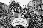 Stephen Roche, the first Irishman to win the Tour de France, proudly waving his winner's yellow jersey as he is paraded through the streets of Dublin. The people of Ireland thronged the streets to congratulate Stephen on his momentous achievement. Lydia Roche and Lord Mayor of Dublin Carmencita Hederman are also in the photograph.<br />