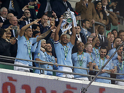 BRITAIN-LONDON-FOOTBALL-CARABAO CUP FINAL-CHELSEA VS MAN London.(190224) -- LONDON, Feb. 24, 2019  Manchester City's captain Vincent Kompany lifts the Cup after the Carabao Cup Final match between Chelsea and Manchester City at Wembley Stadium in London, Britain on Feb. 24, 2019. Manchester City won 4-3 on penalties after a 0-0 draw.  FOR EDITORIAL USE ONLY. NOT FOR SALE FOR MARKETING OR ADVERTISING CAMPAIGNS. NO USE WITH UNAUTHORIZED AUDIO, VIDEO, DATA, FIXTURE LISTS, CLUB/LEAGUE LOGOS OR ''LIVE'' SERVICES. ONLINE IN-MATCH USE LIMITED TO 45 IMAGES, NO VIDEO EMULATION. NO USE IN BETTING, GAMES OR SINGLE CLUB/LEAGUE/PLAYER PUBLICATIONS. (Credit Image: © Matthew Impey/Xinhua via ZUMA Wire)