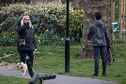 © Licensed to London News Pictures. 04/04/2020. London, UK. A woman argues with man who she claims came to close to her on a skate board, at Paddington Recreation Ground in London, during a pandemic outbreak of the Coronavirus COVID-19 disease. The public have been told they can only leave their homes when absolutely essential, in an attempt to fight the spread of coronavirus COVID-19 disease. Photo credit: Ben Cawthra/LNP