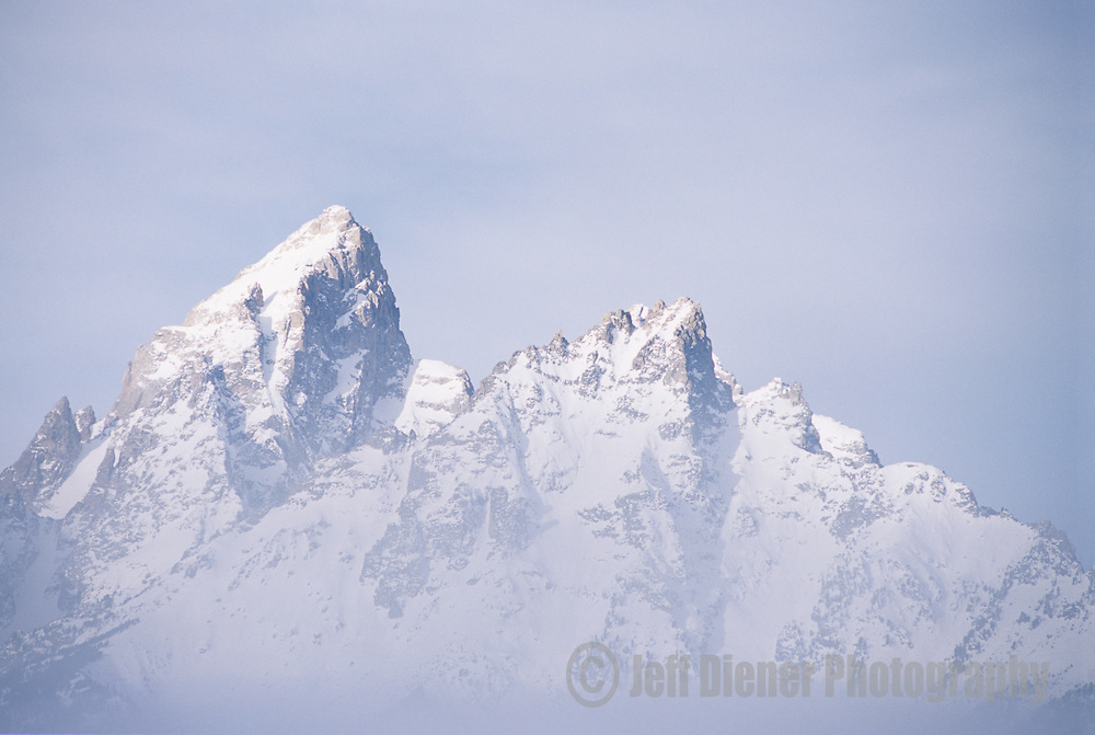 Valley fog shrouds the lower flanks of the Tetons in Grand Teton National Park, Jackson Hole, Wyoming.
