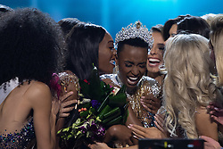 December 8, Atlanta, Georgia, USA: Zozibini Tunzi, Miss South Africa 2019 is congratulated by fellow contestants after being crowned Miss Universe at the conclusion of The Miss Universe Competition at Tyler Perry Studios in Atlanta. The new winner will move to New York City where she will live during her reign and become a spokesperson for various causes alongside The Miss Universe Organization.  (Credit Image: ? Miss Universe Organization/ZUMA Wire/ZUMAPRESS.com)