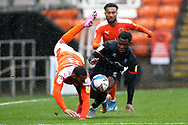 Blackpool forward Keshi Anderson (8) and Lincoln City midfielder Tayo Edun (7) battle for possession during the EFL Sky Bet League 1 match between Blackpool and Lincoln City at Bloomfield Road, Blackpool, England on 3 October 2020.