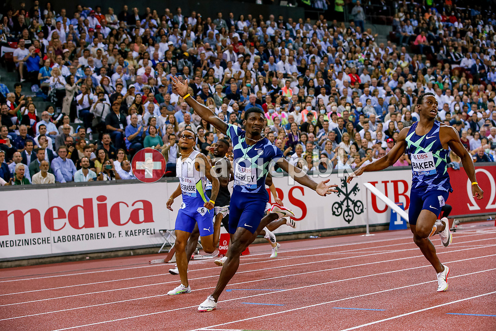 Fred Kerley (C) of the United States celebrates after winning the 100m Men in front of Andre De Grasse of Canada (L) and Ronnie Baker (R) of the United States during the Iaaf Diamond League meeting (Weltklasse Zuerich) at the Letzigrund Stadium in Zurich, Switzerland, Thursday, Sept. 9, 2021. (Photo by Patrick B. Kraemer / MAGICPBK)