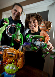 """Charlie and Jack Bright, 16 and 12 years old, respectively, pose for a photograph at their Pleasant Hill, Calif. home, Monday, Nov. 30, 2015. The brothers have both given voice to characters in several Pixar animated movies, including the most recent one, """"The Good Dinosaur,"""" for which Charlie provides the voice of the boy called Spot. (D. Ross Cameron/Bay Area News Group)"""