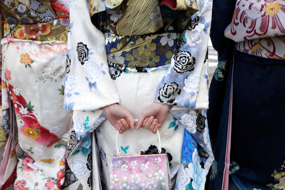 close up of gilrs walking during the day of the Coming of Age festival, Seijin no hi, Japan