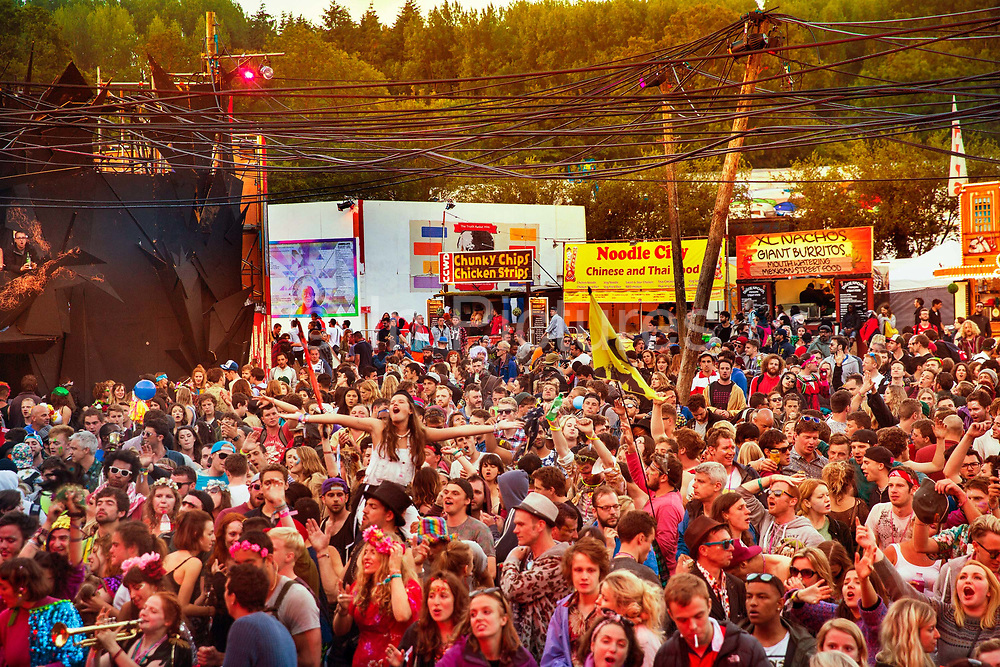 Glastonbury Festival, 2015. Shangri La is a festival of contemporary performing arts held each year within Glastonbury Festival. The theme for the 2015 Shangri La was Protest. The morning after; dancing at dawn in front of the Hell stage.