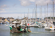 Fishing boat trawler in Channel port of St Vaast La Hougue in Normandy, France
