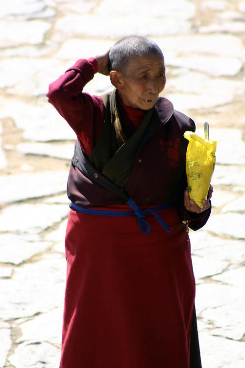 Tibetan female monk at monestary in lhasa tibet