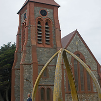 A huge arch made from two blue whale jaws stands in front of Christ Church Cathedral in Port Stanley in the Falkland Islands.  The arch, built in 1933, commemorates 100 years of British rule.