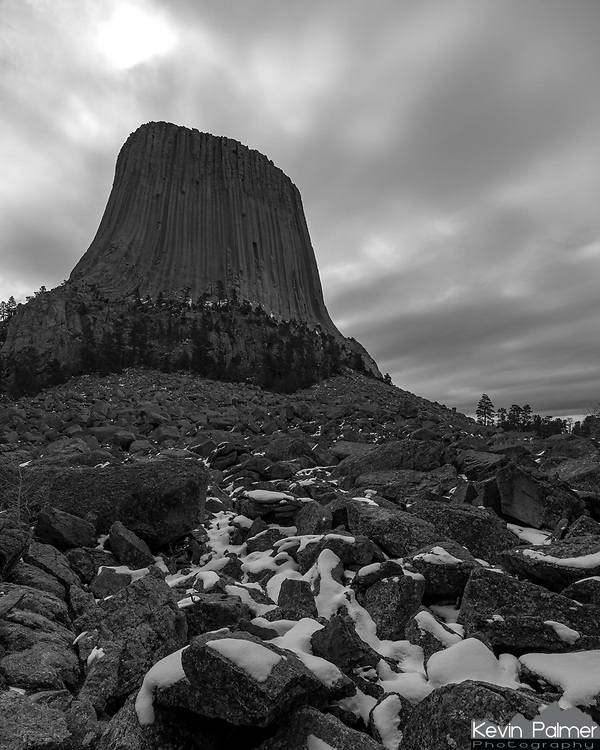Snow covers the boulder field below Devil's Tower on an overcast April morning.