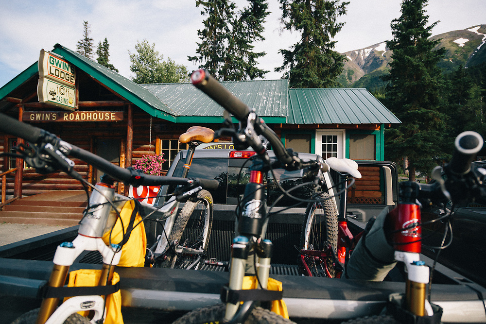 A truck full of mountain bikes parked for dinner at Gwin's Lodge in Cooper Landing, Alaska.