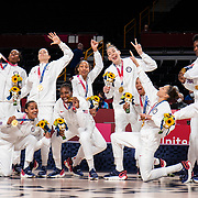 TOKYO, JAPAN August 8:  The United States Women's basketball team strike a pose at the gold medal presentation after the teams victory in the Japan V USA basketball final for women at the Saitama Super Arena during the Tokyo 2020 Summer Olympic Games on August 8, 2021 in Tokyo, Japan. (Photo by Tim Clayton/Corbis via Getty Images)