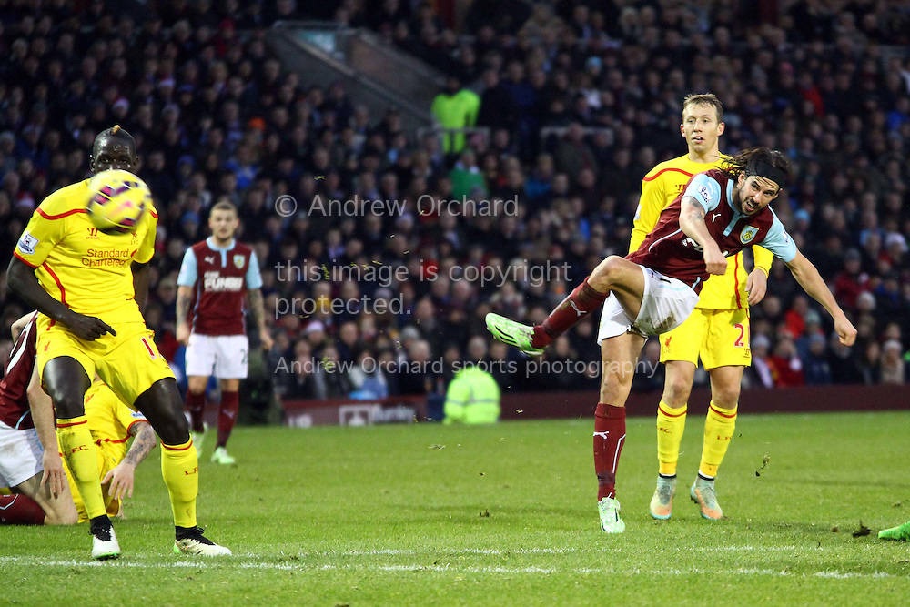 George Boyd of Burnley shoots and hits the post. Barclays Premier league match, Burnley v Liverpool at Turf Moor in Burnley, Lancs on Boxing Day, Friday 26th December 2014.<br /> pic by Chris Stading, Andrew Orchard sports photography.