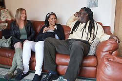Parents and teenage daughter on sofa. Cleared for Mental Health issues.