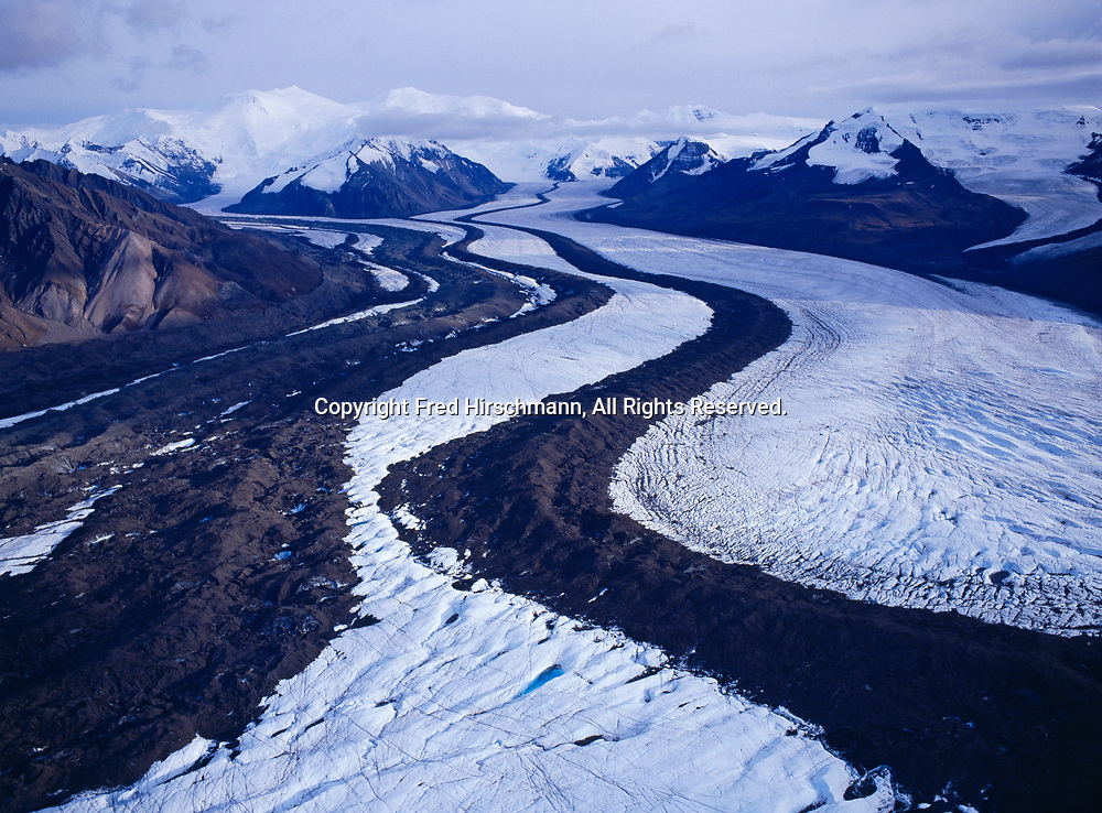 Aerial view of the Russell Glacier with 15,638 foot Mount Churchill and 16,421 foot Mount Bona of the University Range, Saint Elias Mountains beyond, Wrangell-St. Elias National Park, Alaska.