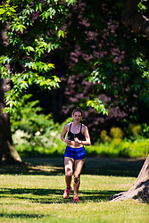 A woman runs through the morning sunshine in Regents Park, London, as the heatwave continues to grip the capital. London, June 29 2018.