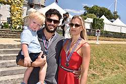 Lady Alexandra Draper, Julian Draper and their son Raphael Draper at the 'Cartier Style et Luxe' enclosure during the Goodwood Festival of Speed, Goodwood House, West Sussex, England. 15 July 2018.