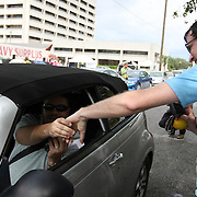 """Kelly Benjamin (right), a local Tampa protester, talks with an unidentified man who is recording him at """"Camp Romney"""", during the Republican National Convention in Tampa, Fla. on Wednesday, August 29, 2012. (AP Photo/Alex Menendez)"""