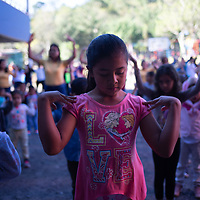"""Children take part in morning exercises at the COMSA International School in Marcala, Honduras. <br /> <br /> Education is a core concern for the leadership and membership of the COMSA coop and the COMSA International School is a long-term initiative by the coop to improve the education of coffee farmers' children in the area. Children are accepted from the age of six months in a pre-kinder, and go up to 18 years old, before going to university. The school has had a lot of success and attention.<br /> The school questions traditional approaches to education and uses some unconventional techniques such as the Glenn Doman method. The children all learn English, French, German and Japanese.<br /> Douglas Penalba, the Glenn Doman method coordinator for the school, explained that """"the Doman method was developed to help children - including children with special needs - to develop and progress in every area, for the children to reach their fullest potential"""". Children in the school play and develop in an atmosphere of freedom, with a high teacher to student ratio, they do well academically and they are unusually successful in languages. Most children at the school study with a grant, subsidised heavily by money from Fairtrade premiums."""