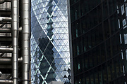 Architecture in the City of London, UK. Her the Lloyds Building interracts in the same are as the Gerkhin as a wall of steel and glass modernism.