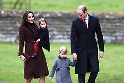 File photo dated 25/12/16 of the Duke and Duchess of Cambridge, Prince George and Princess Charlotte arriving to attend the morning Christmas Day service at St Mark's Church in Englefield, Berkshire. The Duke and Duchess of Cambridge will celebrate their daughter Princess Charlotte's second birthday on Tuesday.