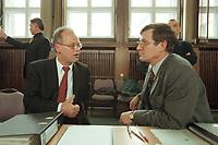 10 JAN 2001, BERLIN/GERMANY:<br /> Rudolf Scharping (L), SPD, Bundesverteidigungsminister, und Walter Stuetzle (R), Staatssekretaer im BMVg, im Gespraech, nach einer Pressekonferenz zur Verwendung von uranhaltiger Munition, Bundesverteidigungsministerium<br /> IMAGE: 20010110-02/02-32<br /> KEYWORDS: Walter Stützle, Staatssekretär