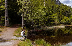THEMENBILD - eine Frau sitzt am Ufer des Biotop und Naturdenkmals Alter See, aufgenommen am 20. Mai 2017 in Tristach, Österreich // A woman is sitting on the shore at the biotope and natural monument Alter See near the Tristachersee on 2017/05/20, Tristach, Austria. EXPA Pictures © 2017, PhotoCredit: EXPA/ JFK