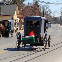 Intercourse, PA / USA - April 6, 2015: Amish buggies use the Old Philadelphia Pike through the Lancaster County village.