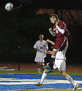 Fort Ann's Tyler Gleason (8) heads the ball toward the goal against Chazy during the Class D state semifinals at Faller Field in Middletown on Saturday. Nov. 16, 2013. Fort Ann's Tyler Ward (21) moves the ball pastHayden Guay (16) of Chazy during the Class D state semifinals at Faller Field in Middletown on Saturday. Nov. 16, 2013. (Tom Bushey – Special to The Post-Star)