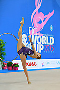 Staniouta Melitina during final at hoop in Pesaro World Cup April 12, 2015. Melitina is an Belarusian rhythmic gymnast, she was born in November 15, 1993 in Minsk. She is a three time World All-around bronze medalist in 2015, 2013, 2010 retired from rhythmic gymnastics in December 2016.